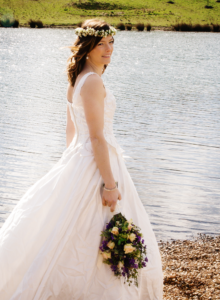 bride on lake edge
